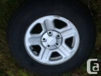 5 Goodyear wrangler tires mounted on jeep rims.