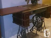 Gorgeous Antique Singer Sewing machines. Both fold down