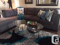 The Marlo Sectional Sofa by Ashley with chaise in