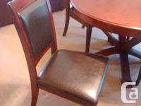 Solid wood dining table in cherry wood finish and 6 of