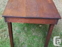 Selling this antique, solid wood table. It's a