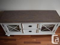 I'm selling a gorgeous classic TV Stand with distressed