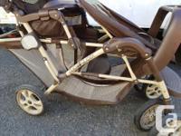 Double Graco stroller. Both seats face forward. Both