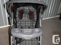 Graco Quattro Stroller: gray plaid; exceptional