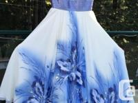 White and blue full length gown with blue flowers, and