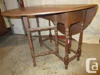 """THIS 1930'S TABLE IS MADE OF WALNUT. IT IS 36"""" WIDE AND"""