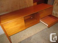 THIS TEAK CREDENDZA IS 59 INCHES WIDE, 18 1/2 INCHES