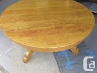 THIS 42 INCH DIAMETER OAK TABLE WAS CUT DOWN TO A