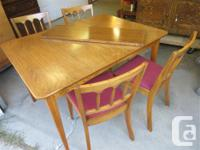 THIS DINING SUITE IS MADE UP OF AN EXTENTABLE TABLE,