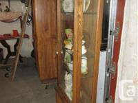 THIS CURIO CABINET IS 25 1/4 INCHES WIDE, 12 1/4 INCHES