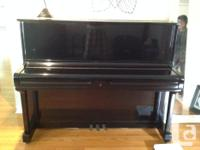 "Grand up right Piano H 47"" x W 59"" black glossy finish."