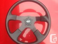 Mint condition black grant steering wheel. Comes with