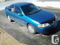 Make Nissan Model Sentra Year 2003 Colour Blue kms