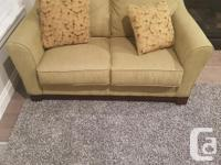 MOTIVATED TO SELL. MUST SEE ASHLEY LOVESEAT FOR SALE ..