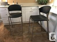 Two high top bar chairs. Very sturdy and in excellent