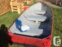 12 foot fishing boat, with a swivel seat in the back.