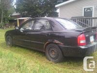 Make Mazda Model Protege Year 2001 Colour Black kms
