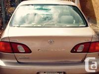 Make Toyota Model Corolla CE Year 2000 Colour Beige