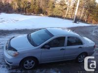 For sale a 2005 silver Toyota Corolla CE. Crown
