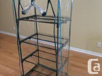 Excellent condition, like new! 4-Tier Mini Greenhouse