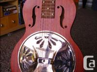 One owner square neck (lap style) resonator guitar.