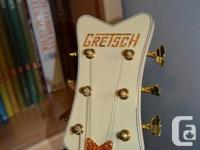 Virtually un-played. This guitar features all gold