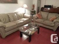 Grey genuine leather sofa and loveseat in very good