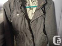 I'm selling a grey TNA canvas jacket for $45 in good