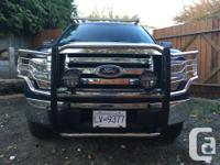 Chrome and black with foglights. Fits 2009-2014 Ford