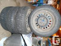 Establish of 4 studded wintertime tires in excellent