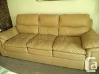 A set of natural leather couch and also love seat. no