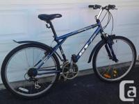 THIS SHIMANO EQUIPPED, 21 SPEED, GT HYBRID HAS A 18