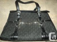 Black Gucci Purse (made in Italy) It is worth $1435.00