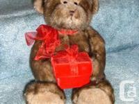 """This BIG PLUSH """" GUND """" TEDDY BEAR wears a red organza"""