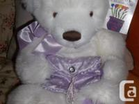 This is a beautiful Gund bear holding a lavender