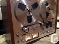 This reel to reel is in attractive aesthetic disorder.