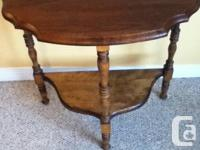 Antique half moon table has been refinished and in