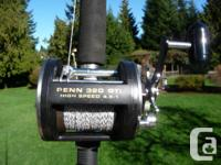 Two Halibut rods with reels. One is a 7 ft. with a