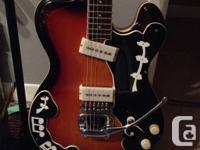 Selling a Hallmark Deke Dickerson model guitar.
