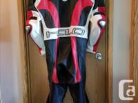 Purchased this new leather racing suit with a race bike