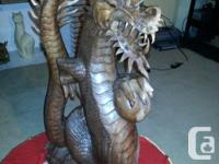 HEY I AM SELLING A 40 INCH HAND CARVED WOODEN DRAGON