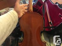 The Fiddle is 15 years old. Comes with a case, a bow,
