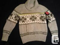 Hand knit wool sweater. This sweater is like new