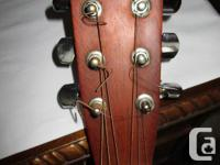 THIS IS A NORMAN B.20 GUITAR MADE IN CANADA. IT IS 16