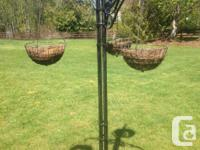 Hanging basket stand that holds three baskets. Very