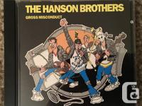 Two Handsome Brothers CDs, one Hanson Brothers Presents