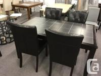Stylish hardwood dining table with real tile inset