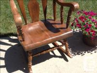 Solid wood rocking chair. 44 inches H, 24 1/2 inches W,