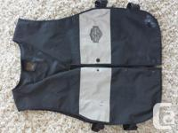 Black and grey reflective vest for over your riding