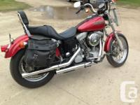 This Harley is patriot red,spoked rims,leather settle
